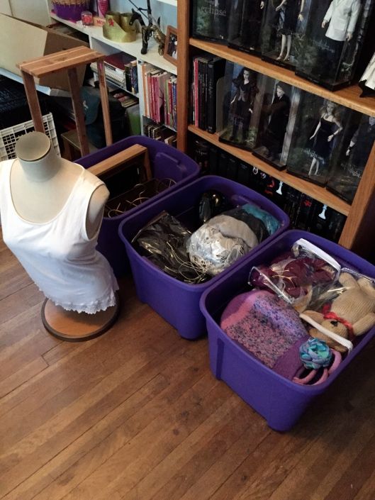 Tubs are packed with inventory and props for today's craft show set-up.